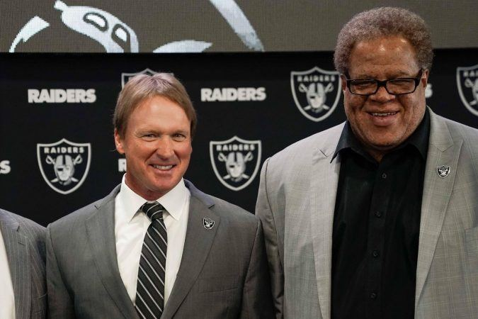 Oakland Raiders coach Jon Gruden, left, expressed shock at the firing of general manager Reggie McKenzie on Monday. (Image: USA Today Sports)