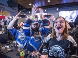 Seattle hockey fans celebrate after the announcement was made Tuesday that their city was getting an NHL franchise. (Image: Seattle Times)