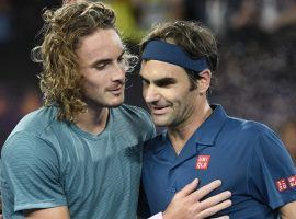 Roger Federer (right) was defeated by Stefanos Tsitsipas (left) in the fourth round of the 2019 Australian Open. (Image: AP)