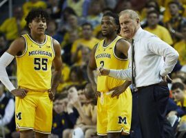 Michigan guards Eli Brooks (55) and Zavier Simpsons (3) with head coach John Beilein (right) during a home game in Ann Arbor. (Image: Rick Osentoski/USA Today Sports)