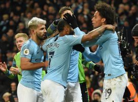 Leroy Sane (right) celebrates with his teammates after scoring the winning goal in Manchester City's 2-1 victory over Liverpool on Thursday. (Image: AFP)