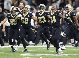 The New Orleans Saints, led by Marcus Lattimore (23), celebrate their victory over the Philadelphia Eagles in the Superdome in New Orleans. (Image: AP)