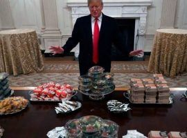 President Donald Trump stands before a meal of hamburgers and pizza he said he bought for the Clemson football team. (Image: AP)
