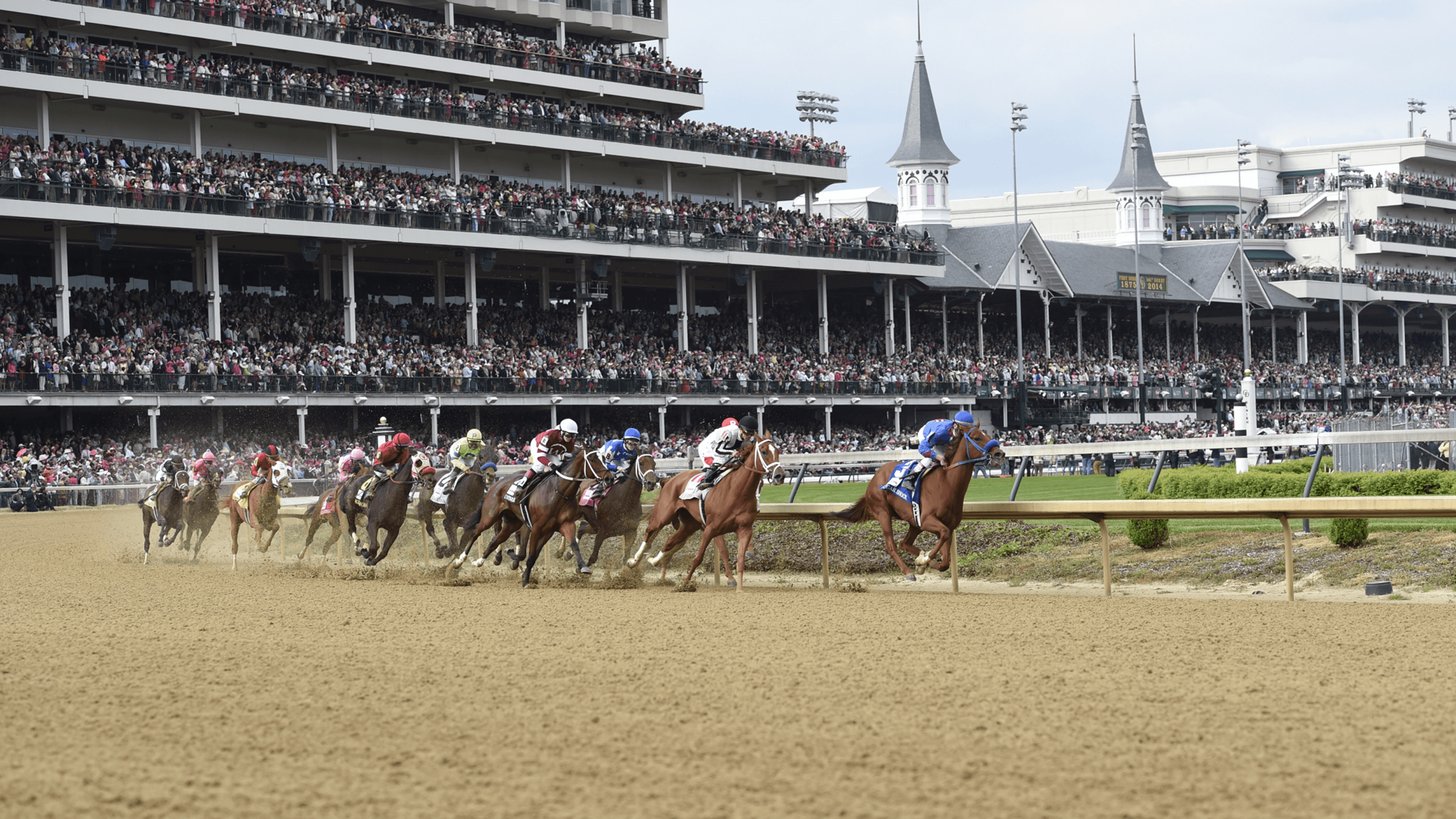 Derby horses round the first turn at Churchill Downs
