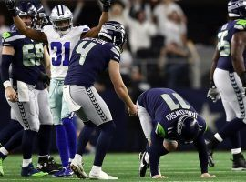 Seattle Seahawks kicker Sebastian Janikowski (11) falls to the turf moments after injuring his hamstring after a field goal attempt in Dallas. (Image: AP)