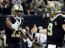 New Orleans Saints QB Drew Brees congratulates WR Michael Thomas after a touchdown drive in the Superdome. (Image: Chris Graythen/Getty)