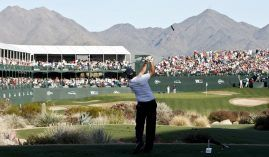 Phil Mickelson tees off at the iconic 16th hole at TPC Scottsdale at the Waste Management Phoenix Open. (Image: AP)