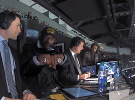 Rapper Snoop Dogg, center, shows off some bling as he joined Alex Faust, left, and Jim Fox in the television booth as an announcer at Saturday's Los Angeles Kings game. (Image: Courtesy LA Kings)