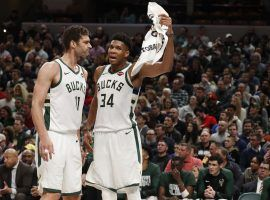 Brook Lopez and Giannis Antetokounmpo from the Milwaukee Bucks sharing intel during a timeout at Fiserv Forum in Milwaukee. (Image: Brian Spurlock/USA Today Sports)
