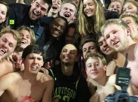 Steph Curry, a Davidson Alumni currently playing with the Golden State Warriors, jumped into the student section after a victory over St. Joe's at John M. Belk Arena in Davidson, NC. (Image: ESPN)