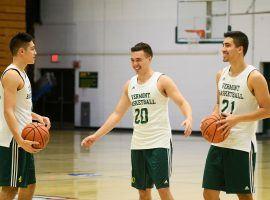 Robin Duncan, left, Ernie Duncan and Everett Duncan shoot around at practice at Patrick Gymnasium in Burlington, Vermont. (Image: Brian Jenkins/Vermont Free Press)
