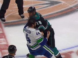 Vancouver Canucks defenseman Erik Gudbranson (left) and Anaheim Ducks captain Ryan Getzlaf tussle in the second period at the Pond in Anaheim, CA. (Image: YouTube)