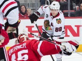 Patrick Kane from the Chicago Blackhawks shooting against Detroit Red Wings goalie Jonathan Bernier. (Image: Dave Reginek/Getty)