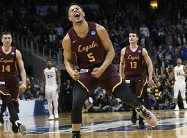 Loyola-Chicago guard Marques Townes (5) celebrates after hitting a shot against Nevada during the 2018 March Madness regional semifinal. (Image: John Amis/AP)