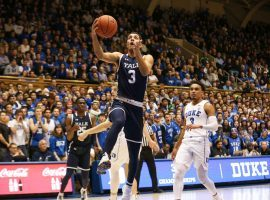 Senior guard Alex Coepland from Yale drives to the basket against Duke in Durham, North Carolina. (Image: Keenan Hairston/Yale Daily News)