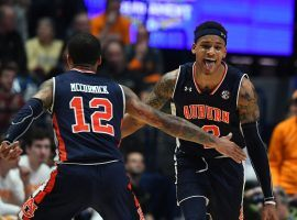 Auburn Tigers guards J'Von McCormmick (12) and Bryce Brown (2) celebrate after defeating Tennessee in the SEC tournament in Nashville, TN. (Image: Christopher Hanewinckel/USA Today Sports)
