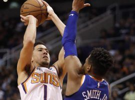 Devin Booker of the Phoenix Suns rises for a shot over Dennis Smith of the New York Knicks at Talking Stick Resort Arena in Phoenix, Arizona. (Image: AP)
