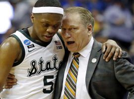 Michigan State guard Cassius Winston consults with head coach Tom Izzo in a March Madness Sweet 16 game against LSU in Washington, DC. (Image: Porter Lambert/USA Today Sports)