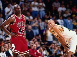 Michael Jordan (45) of the Chicago Bulls returns for his first game back after retirement on March 19, 1995 against Reggie Miller and the Indiana Pacers Market Square Arena in Indianapolis, Indiana. (Image: Barry Gossage/Getty)