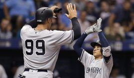 After NY Yankees RF Aaron Judge (99) hits a home run, he is congratulated by teammate Ronald Torreyes. (Image: Rich Schultz/Getty)