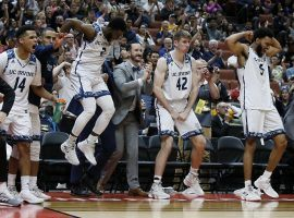 Max Hazzard (2) and the UC Irvine bench react to a blowout over Cal State Fullerton in the Big West tournament championship in Anaheim, California. (Image: Alex Gallardo/AP)