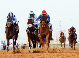 Plus Que Parfait (red cap) sweet in UAE Derby. Image: (Virendra Saklani/Gulf News)