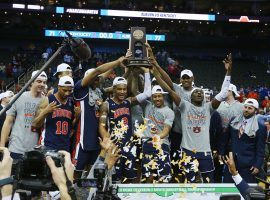 The Auburn Tigers celebrate their first trip to the Final Four with a victory over Kentucky in the Elite 8 in Kansas City, MO. (Image: Jay Biggerstaff/USA Today Sports)