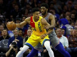 Giannis Antetokounmpo (left) and the Milwaukee Bucks clinched the NBA's best record with a win over the Philadelphia 76ers on Thursday. (Image: Matt Slocum/AP)