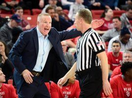 Chris Mullin, coach of St. John's, chats with an official during a game against Butler at Carnesecca Arena in Queens, NY. (Image: Steven Ryan/Getty)