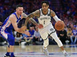 The Brooklyn Nets D'Angelo Russell drives by Philadelphia 76ers guard JJ Redick during Game 1 of the playoffs at Wells Fargo Center in Philadelphia, PA. (Image: Getty)