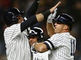 NY Yankees outfielder Mike Tauchman (left) congratulates Brett Gardner (11) after hitting a grand slam against the Boston Red Sox at Yankee Stadium in the Bronx. (Image: Adam Hunger/USA Today Sports)