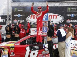 Kyle Busch outraced his brother Kurt off a late restart to win on Sunday at Bristol Motor Speedway. (Image: Wade Payne/AP)