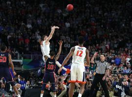 Virginia's Kyle Buy shoots a three-pointer over Auburn's Samir Doughty in a Final Four game at US Bank Stadium in Minneapolis, Minnesota. (Image: Getty)