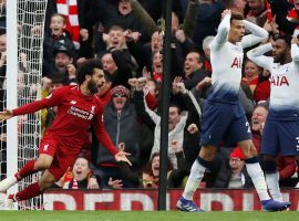 Liverpool's Mohamed Salah (left) celebrates after a late own goal gave his team a 2-1 win over Tottenham on Sunday. (Image: Paul Childs/Action Images/Reuters)