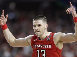 Texas Tech's Matt Mooney celebrating after hitting a three-point shot against Michigan State in a Final Four game in Minneapolis, MN. (Image: AP)