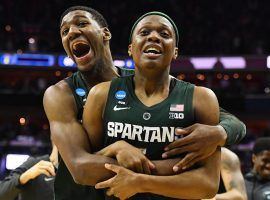 Michigan State forward Aaron Henry embraces guard Cassius Winston moments after Michigan State's victory over Duke in the March Madness Elite 8 game in Washington, DC. (Image: Patrick Smith/Getty)