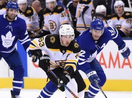 The Boston Bruins and Toronto Maple Leafs will be forced to play each other in the first round of the NHL playoffs due to the division format used by the league. (Image: Dan Hamilton/USA Today Sports)