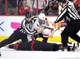 Officials separate Alex Ovechkin from the Washington Capitals after he knocked out Andrei Svechnikov from the Carolina Hurricanes in a fight in the first period of a playoff game in Raleigh, North Carolina. (Image: Getty)