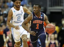 Auburn point guard Jared Harper (1)chased down by North Carolina guard Coby White in the March Madness Sweet 16 in Kansas City, MO.  (Image: Christian Petersen/Getty)
