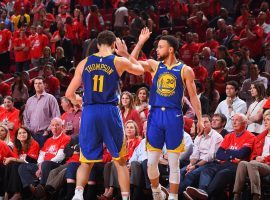 Klay Thompson (left) and Steph Curry (right) lead the Golden State Warriors to a series win in Game 6 against the Houston Rockets in Houston, Texas. (Image: Bill Baptist/Getty)