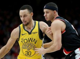 Steph Curry of the Golden State Warriors playing against his younger brother, Seth Curry, from the Portland Trailblazers at the Moda Center in Portland, OR. (Image: Abbie Parr/Getty)