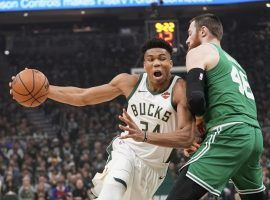 Giannis Antetokounmpo of the Milwaukee Bucks drives by Aron Baynes from the Boston Celtics in Game 5 of the Eastern Semifinals in Milwaukee, WI. (Image: Morry Gash/AP)