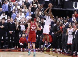 Kawhi Leonard of the Toronto Raptors takes a shot as time expires over Joel Embiid of the Philly Sixers at Scotiabank Arena in Toronto, Canada. (Image: Charles Fox/Philly.com)