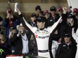 Brad Keselowski took the lead late and then held on in a shootout to win at Kansas Speedway on Saturday. (Image: Orlin Wagner/AP)