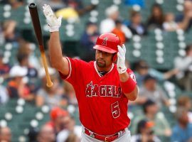 Albert Pujols, first baseman from the LA Angels, tosses his bat after hitting a home run that secured his 2,000 career RBI during a game against the Detroit Tiger in Detroit, MI. (Image: Paul Sancya/AP)