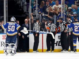 St. Louis Blues players argue with referees after the San Jose Sharks score the game winning goal in overtime of Game 3 of the Western Conference finals. (Image: Jeff Roberson/AP)