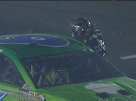 Clint Bowyer went up to Ryan Newman's car after the All-Star Race and punched him through the window. (Image: Fox Sports)