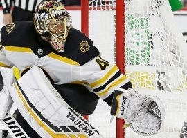 Tuukka Rask, goalie for the Boston Bruins, fends off a puck against the Carolina Hurricanes in the Eastern Conference Finals. (Image: AP)
