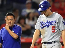 Corey Seager (right) will likely miss up to six weeks with what the Dodgers believe is a Grade 2 hamstring strain. (Image: Getty)