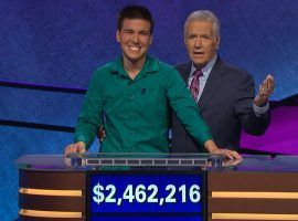 James Holzhauer, with host Alex Trebek, after winning his 32nd consecutive match on Jeopardy! (Image: Sony Pictures Television)